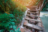 Waterfall on wooden stairs at Kanchanaburi province,Thailand.