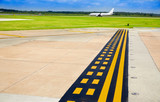 Airport signals in pavement with aircraft - 206977474