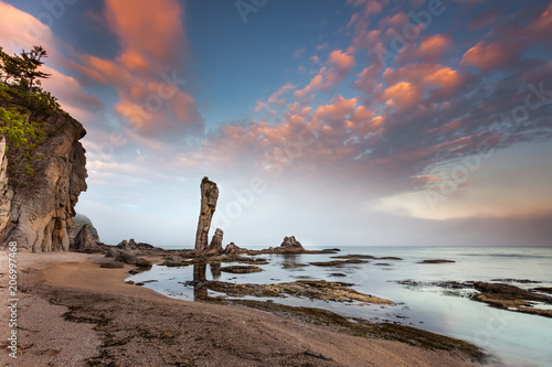 Fotobehang Strand Amazing seascape photo of a beautiful bay with rocks and clouds