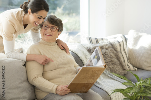 Leinwanddruck Bild Grandmother with tender caregiver