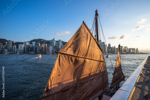 Fotobehang Schip sailboat with city skyline in hongkong china