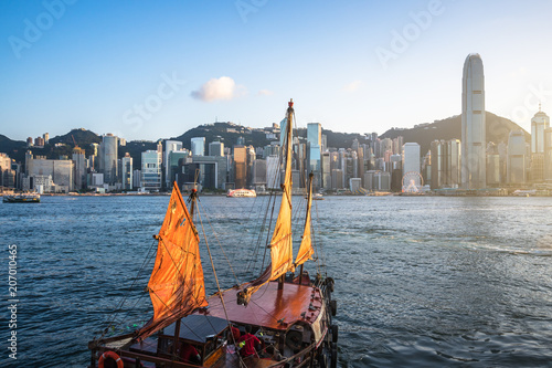 sailboat with city skyline in hongkong china