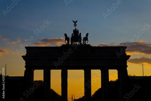 Fotobehang Berlijn Silhouette of the Brandenburg gate (Brandenburger Tor) with sunset sky background