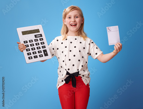 Fotobehang Apotheek smiling child showing prescription and calculator on blue