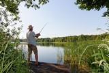 fisherman catching the fish durring sunny day - 207025296