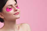 Attractive young woman having under eye mask - 207035002