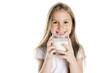 Leinwanddruck Bild - Portrait of a cute 7 years old girl Isolated over white background with milk glass
