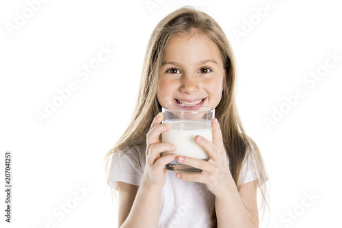 Leinwanddruck Bild Portrait of a cute 7 years old girl Isolated over white background with milk glass