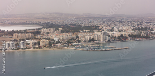 Fotobehang Cyprus Cyprus, Larnaca aerial view. Multi-storey buildings, sandy beach, blue sea and sky