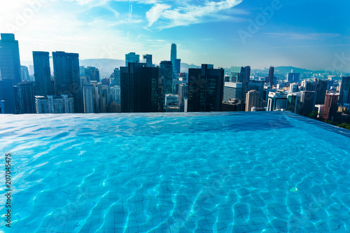 Luxury Swimming pool on rooftop with cityscape