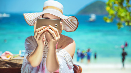 Relaxed lady taking a photo - tropical area