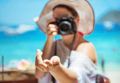 Fotobehang Konrad B. Relaxed lady taking a photo - tropical area