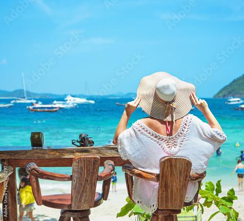 Fotobehang Konrad B. Young lady relaxing in a beach bar
