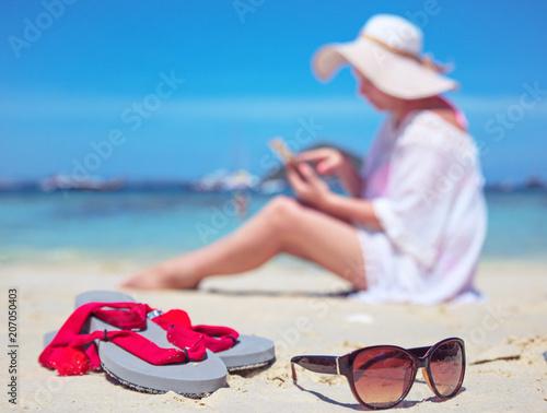 Fotobehang Konrad B. Relaxed woman on a beach