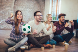 Happy friends or football fans watching soccer on tv and celebrating victory. Friendship, sports and entertainment concept. - 207055671