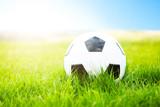 Soccer ball or football ball on green field - 207087656