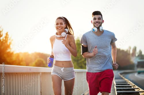 Fotobehang Hardlopen Couple jogging outdoors