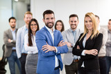 Portrait of business team posing in office - 207095862