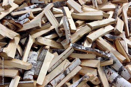 Fototapeta Pile of chopped fire wood prepared for winter
