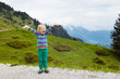 Leinwanddruck Bild - Children hiking in Alps mountains. Kids outdoor.