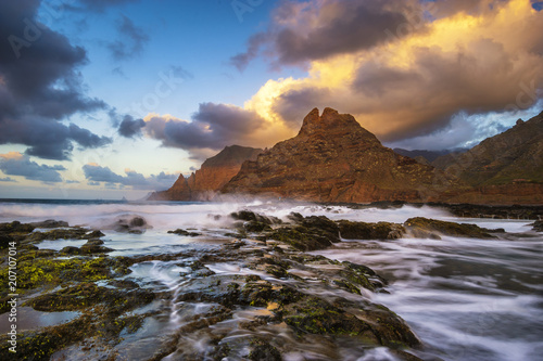 Fotobehang Strand beautiful, dynamic sunset over a volcanic beach by the ocean - punta del hidalgo, Tenerife