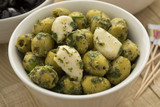 Bowl with green olives, garlic and cilantro
