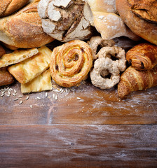 Bakery products: bread, flat bread, donuts and pastries. Top view with space for text