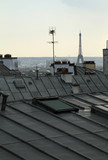 View over Paris rooftops with the Eiffel tower in the background