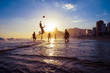 Quadro sunset silhouettes playing keepy-uppie beach football on the sea shore in Ipanema Beach Rio de Janeiro Brazil
