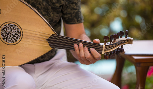 playing an Arabic stringed musical instrument - 207128876