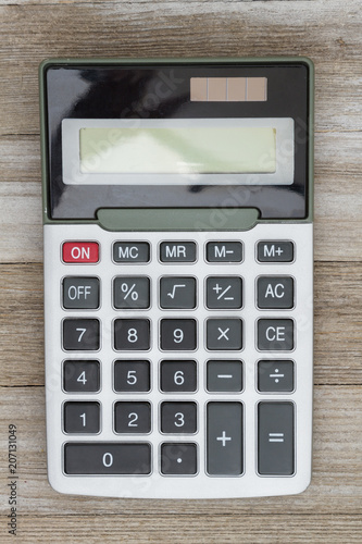 Calculator on weathered wood - 207131049