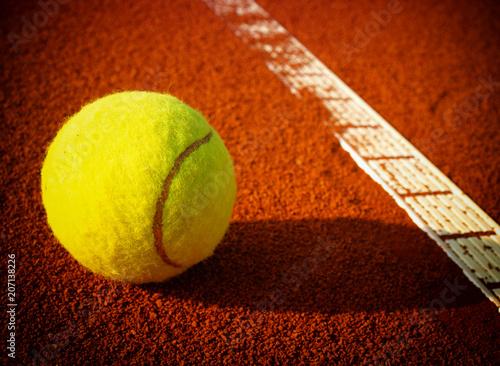 Fototapeta Tennis balls on a tennis clay court