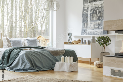 Spacious bedroom interior with fireplace - 207142607