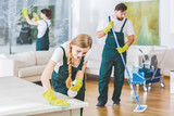 Cleaning service employees with professional equipment cleaning a private home after renovation - 207143275