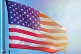 the American flag is flying in a strong wind - 207147842