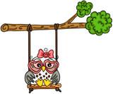Cute owl girl swinging on a tree