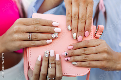 Fotobehang Manicure Close up of bag with girls hands with manicure over it.