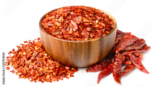 Aluminium Hot chili peppers dried red chilli flakes in the wooden bowl, isolated on white