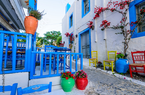 Fototapeta Beautiful street with flowers in the old town of Kos, Kos island, Dodecanese Islands, Greece