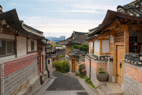 Fotobehang Seoel Traditional Korean style architecture at Bukchon Hanok Village with N Seoul Tower in background in Seoul, South Korea.