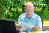 senior man reading the letter - 207238048
