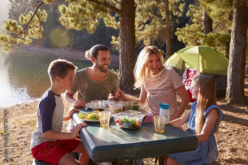 Family Camping By Lake On Hiking Adventure In Forest - 207257431