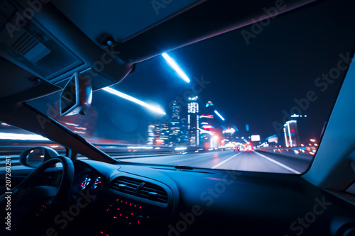 Car speed drive on the road in night city - 207260241