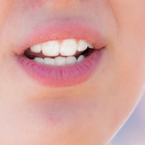 The girl's mouth speaks. Macro - 207267091