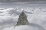 A man standing on a stone cliff over the clouds