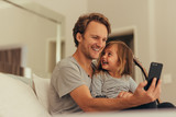 Father and daughter spending time together at home - 207274274