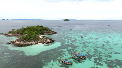 Bird's eye view of tropical beach with crystal clear turquoise water on 'Koh Kra' island, Koh Lipe,Thailand
