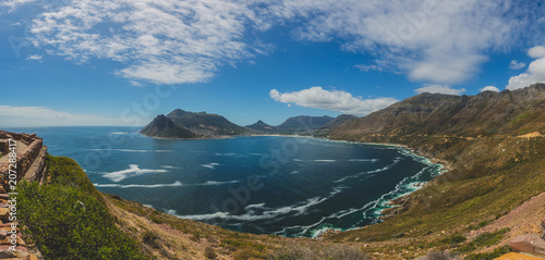 Panorama of Hout Bay in Cape Town with blue sky © bradleyvdw