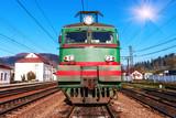 old electric locomotive on rails