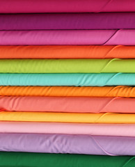 rolls of colorful cotton material cloth on store specializing in